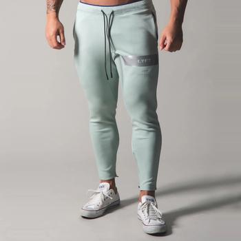 Męskie spodnie dresowe Fitness kulturystyka męskie spodnie na co dziń z nadrukiem mężczyźni spodnie joggery bawełniane spodnie dresowe Slim w stylu Fit Streetwear męski spodni tanie i dobre opinie Muscle Diamond Mieszkanie COTTON PATTERN skinny 2 3 - 3 2 Pełnej długości CK20 Na co dzień Midweight Suknem Elastyczny pas