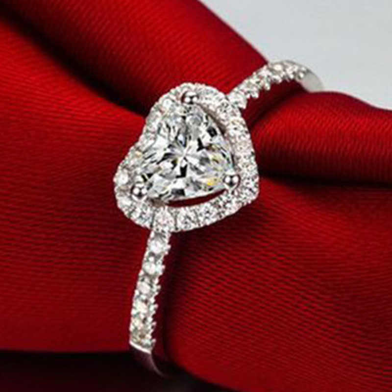 ファッションクリスタルハート形の結婚指輪女性のジルコンの婚約指輪グラマージュエリー