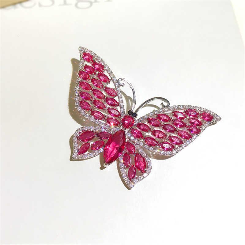 Güzel kelebek broş kadınlar için lüks kırmızı kristal Rhinestone düğün broş elbise kanat broş broş noel hediyesi