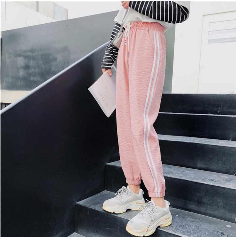 スウェットパンツ女性のパンツカプリパンツ因果ズボンフィットネスルースハーレムパンツアンクル丈サイドストライプバギージョギングパンツ女性ピンク