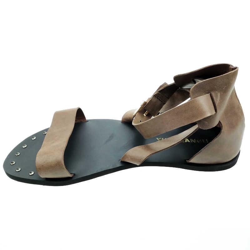 Roman Sepatu Pria Vogue Fashion Gesper Hollow Keluar Tali Gladiator Flats Sepatu untuk Pria Kulit Sandal Kancing Sepatu Punk
