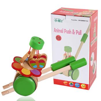 Drewniane zabawki edukacyjne dla dzieci Cartoon Animal Cart Baby Single Rod pchanie muzyki tanie i dobre opinie