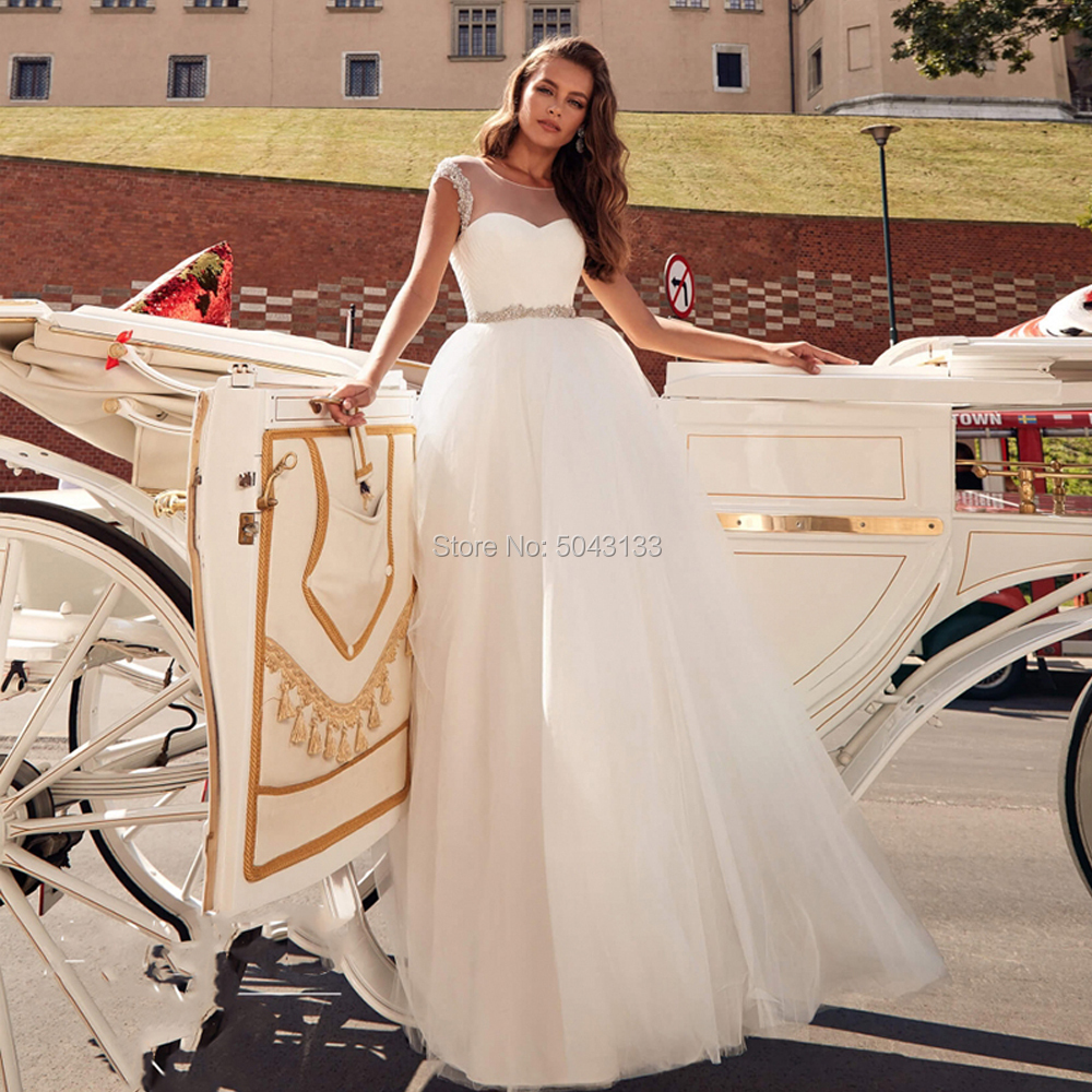 Charming A Line Tulle Wedding Dresses 2019 Sheer Scoop Neck Cap Sleeves Princess Wedding Gowns With Beaded Sash Vestidos Noiva