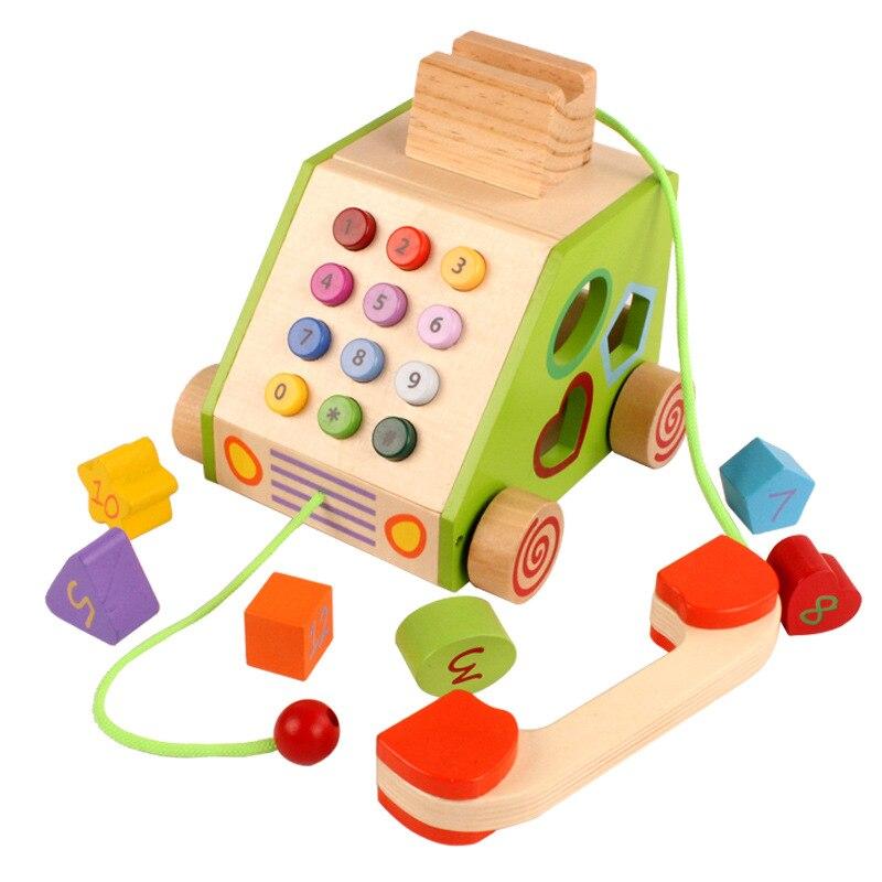 Jeu éducatif en bois modèle de téléphone jouer maison jouets en bois forme assortie blocs d'unité de traînée sur roues avec chiffres cognitifs