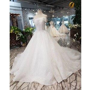 Image 1 - BGW HT5622 סטרפלס חתונת שמלות Boho כבוי כתף מחוך לבן מבריק שמלות כלה עם רכבת אופנה חדשה Vestidos דה Novia