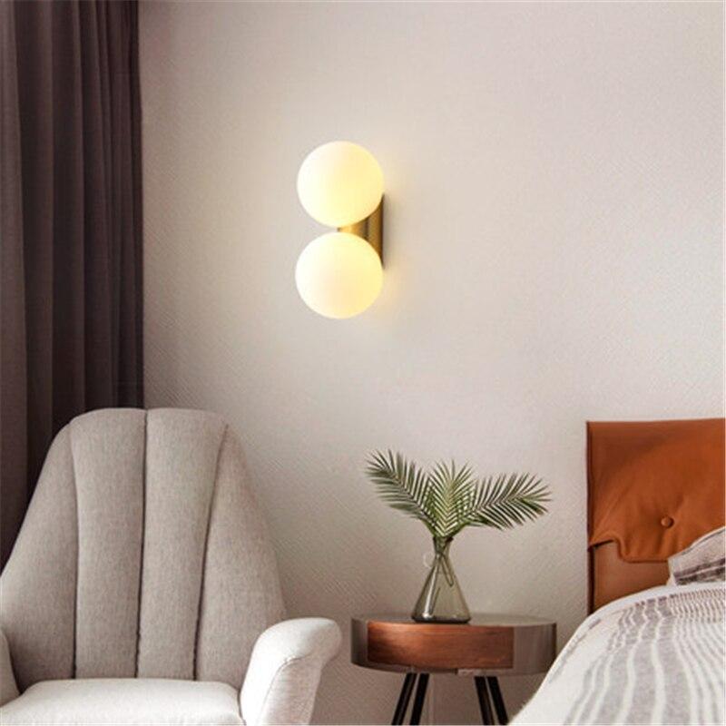 Işıklar ve Aydınlatma'ten LED İç Mekan Duvar Lambaları'de Iskandinav Duvar Lambası Modern Minimalist Yatak Odası Giyim Mağazası Işık Bakır Oturma Odası Balkon Duvar Lambası Yaratıcı Koridor Işıkları title=