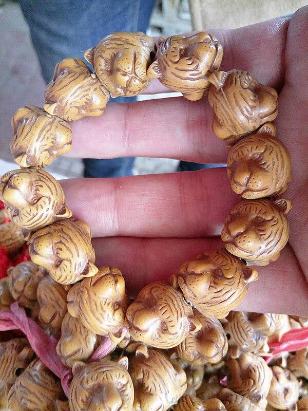 Esta é uma tradução automática de madera artesanías. Desenho de cabeza de leopardo. Cai de Ping