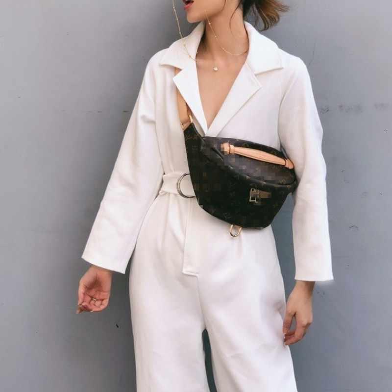 Marka Runway kobiety mieszanki wełniane kombinezony eleganckie wysokiej talii skrzydła długi kombinezon kobiet biały luźny strój jednoczęściowy