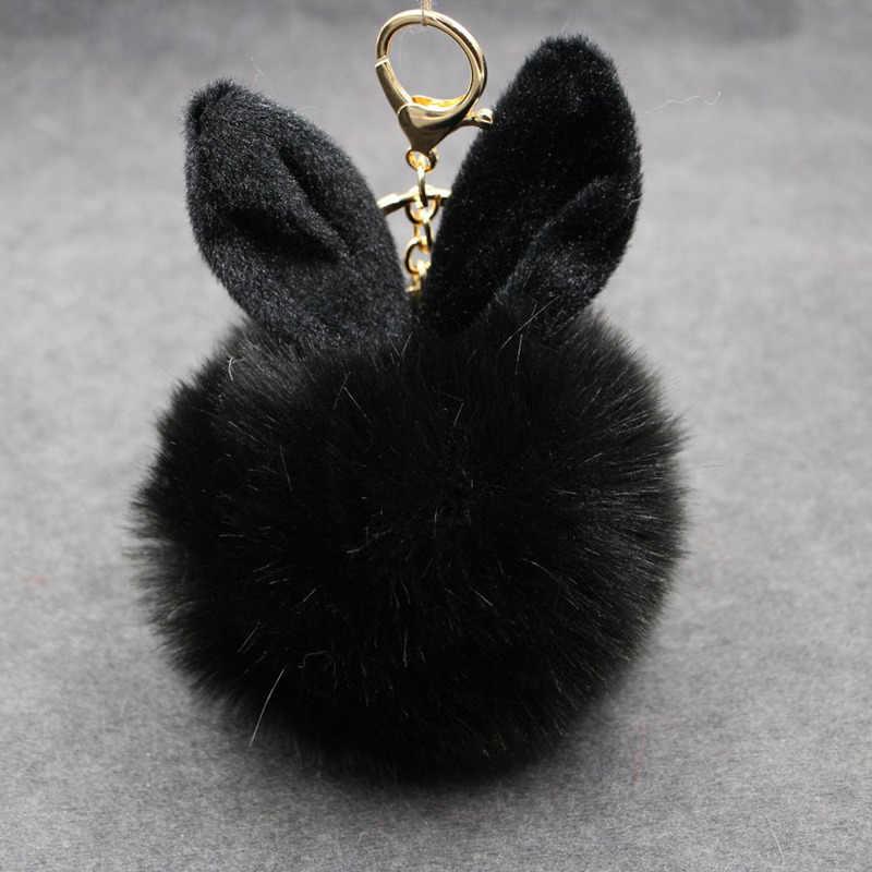 Novo coelho fofo brinquedos orelha chaveiro coelho pele mulher saco encantos chaveiro pom pom pompom pingente de carro titular jóias
