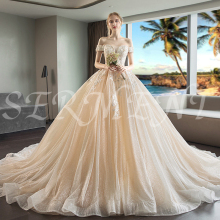 цена Tassel Luxury Wedding Dress Rental Wedding Dress Style Off The Shoulder Empire Lace Up Royal Train Free Custom Made Plus Size