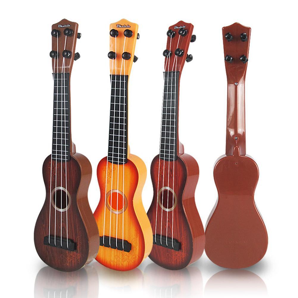 None 4 Strings Kid's Plastic Musical Mini Ukulele Small Educational Hand Guitar Toys For Child