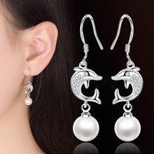 купить Fashion Female Popular Stud Earrings for women Jewelry Fish With Cubic Zirconia Drop Earrings Silver Plated Pearl Dangle Earring по цене 240.33 рублей