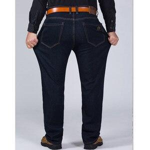 Image 2 - 2020 150KG chaud jean épaissir noir hommes élastique taille haute homme hiver pantalon grande taille 44 46 48 50 52 classique Denim polaire pantalon