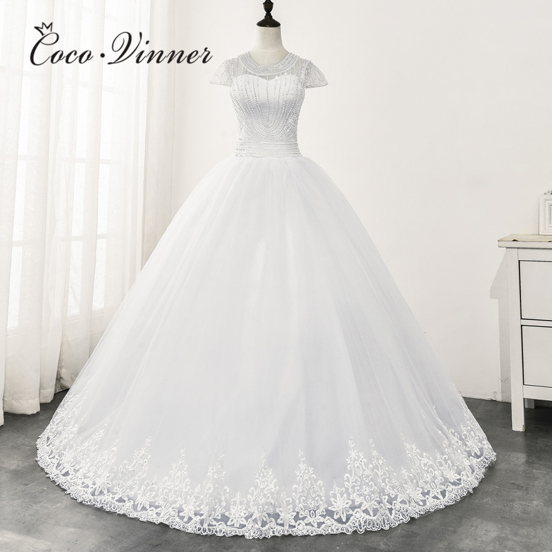 Short Cap Sleeve Pearls Beading Wedding Dress 2020 Africa New Design Sheer Neck Elegant Pure White Wedding Dresses WX0165