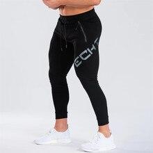 Siłownie czarne spodnie dresowe biegaczy spodnie obcisłe męskie spodnie typu Casual męskie Fitness Workout bawełniane spodnie do biegania jesienno zimowa odzież sportowa