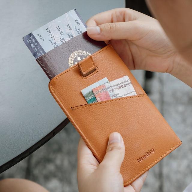 NewBring Funda de cuero para pasaporte para hombre y mujer, Cartera de viaje para tarjeta de crédito, talonario, titular de la identificación, Clip para billetes, monedero, porta pasaporte
