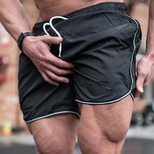 2020 szorty gimnastyczne mężczyźni szybkie suche na szorty do biegania mężczyzn Fitness Sport szorty męskie sporty treningowe krótkie spodnie sportowe męskie odzież tanie tanio GYKZ Na co dzień YZ-DK-20 Poliester Sznurek Stałe REGULAR Kieszenie Summer Leisure sports fashion fitness sports and leisure