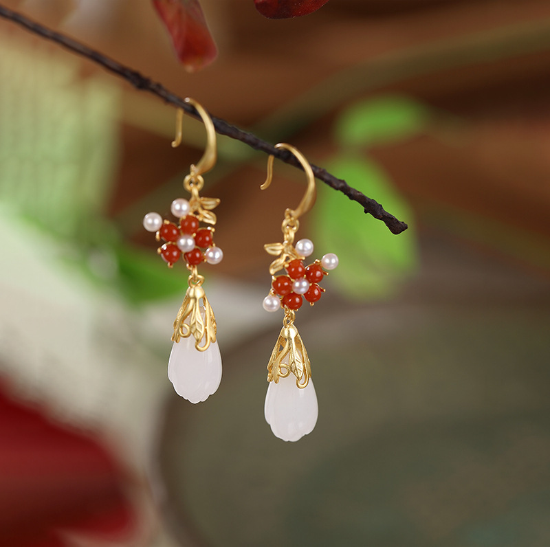 Sterling Silver high-grade personality Plum Blossom Jade orchid lady earrings and Tianyu temperament inlaid Earrings
