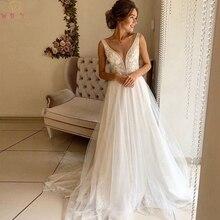 Simple Boho A-Line Wedding Dresses 2019 V-Neek Sleeveless Sequins Bridal Gowns Appliques Illusion Back Tulle vestidos de noiva