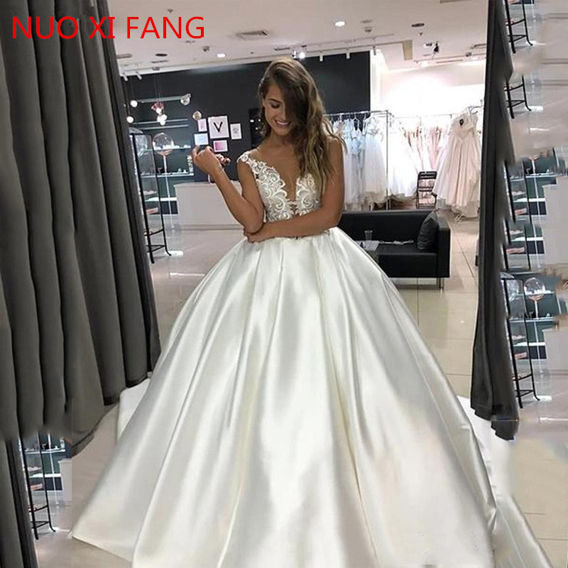 NUOXIFANG New Princess Wedding Dress Top Lace Appliqued A-Line Bride Dresses With Pockets Boho 2020 Dubai Wedding Gowns