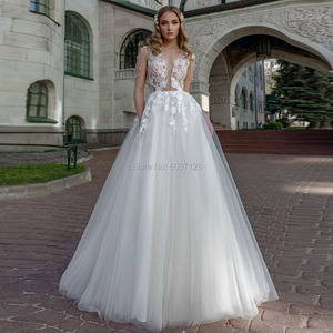 Image 1 - Beach Wedding Dresses 2019 A Line Lace Applique Scoop Illusion Tulle Wedding Bridal Gowns Cap Sleeve Robe De Mariee 2019