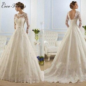 Image 1 - Vestidos De Noiva الكرة ثوب الزفاف 2020 طويلة الأكمام اللؤلؤ تول رداء Ee Mariage Casamento ثوب زفاف الصين W0009