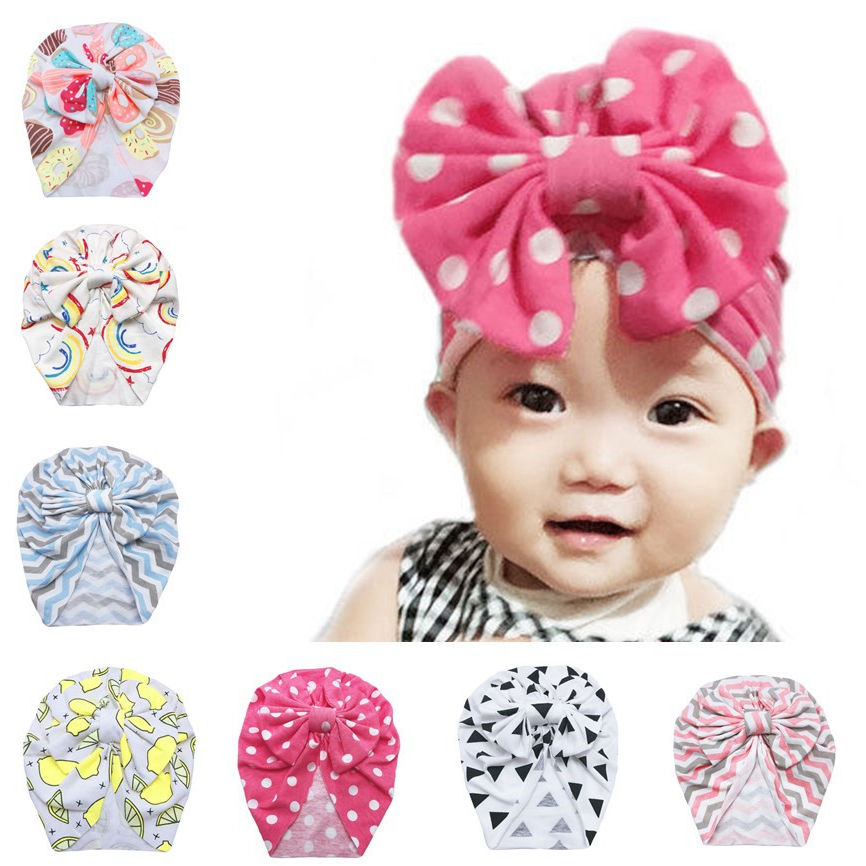 Winter baby skullies beanie warm cotton Kids bonne Baby shower gift Knitted turban hat with bow Soft beanies for newborn H078S in Hats Caps from Mother Kids