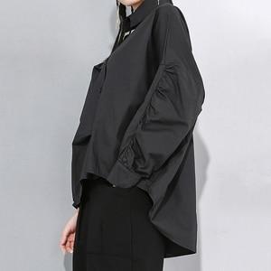 Image 5 - [EAM] Women White Asymmetrical Split Big Size Blouse New Lapel Long Sleeve Loose Fit Shirt Fashion Tide Spring Autumn 2020 1N189