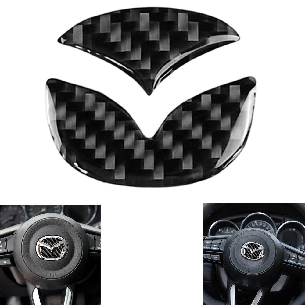 2 uds, pegatinas para el volante del coche, pegatinas con Logo de fibra de carbono, pegatinas de estilo decorativo para Mazda Axela ATENZA CX-5 CX-4