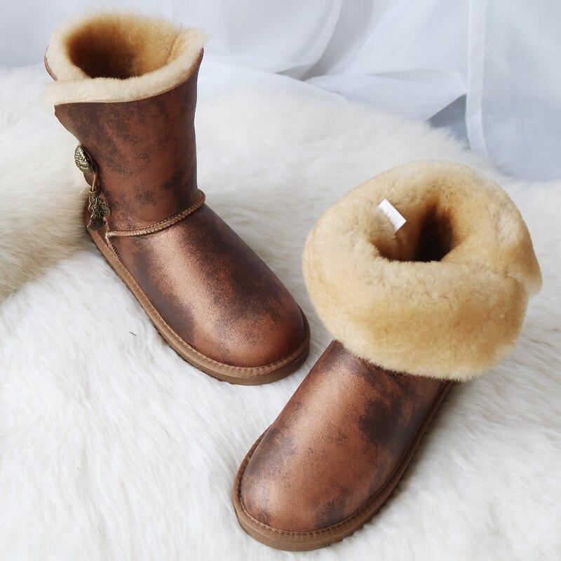 Marque femmes bottes de neige en peau de mouton véritable Learher bottes Matel bouton gland laine bottes de neige hiver plat imperméable chaussures de mouton