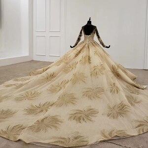 Image 2 - HTL1124 זהב תחרה חתונה שמלות נסיכה לחתוך o צוואר פאייטים ארוך שרוול שמלות כלה שמפניה vestido דה noiva מנגה longa