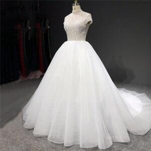 Image 2 - White Sparkle Short Sleeve Tulle Wedding Dresses 2020 High Neck Sequins Beading Bridal Gowns HA2280 Custom Made