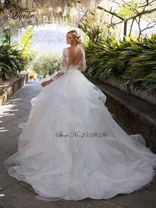 Image 2 - Liyuke الكشكشة ألف خط فستان زفاف الأميرة مع كم طويل من فستان عروس بلا ظهر