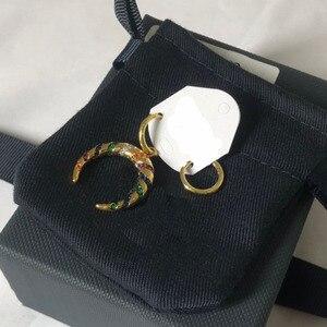 Image 2 - Umgodly moda brincos amarelo cor de ouro assimétrico multicolorido zircão listras lua crescente tribal brincos hoop feminino jóias
