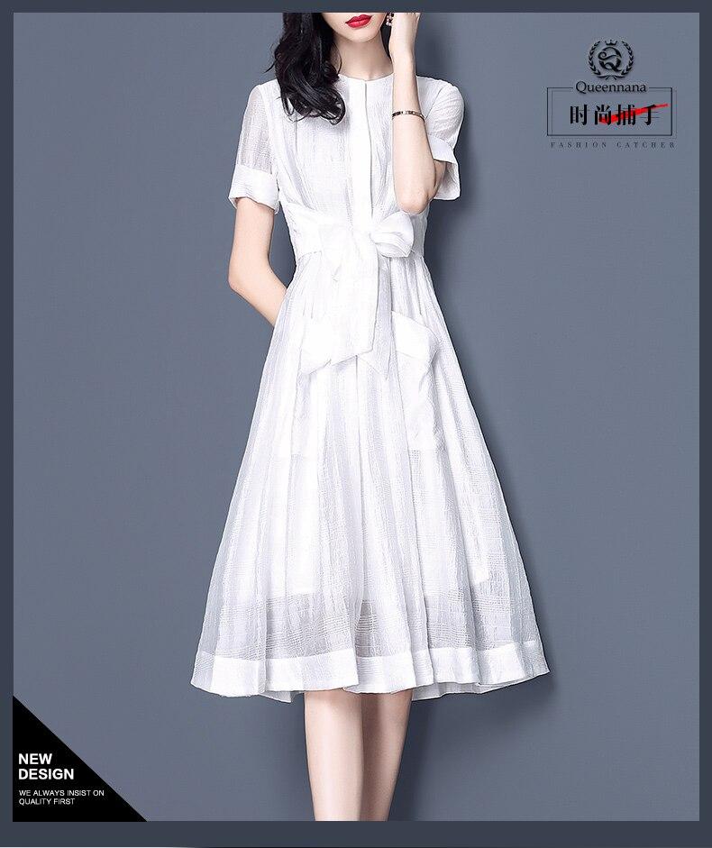 Automne été blanc à manches courtes robe de 2019 nouveau style tempérament taille-longueur net fil a-ligne robe
