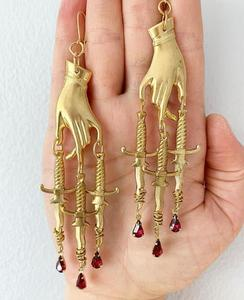 The Golden Hand & Dagger Earrings,gothic Earrings,statement earrings,witchy
