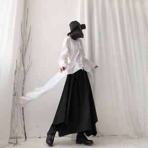 Image 4 - [Eam] 女性黒非対称リボンブラウス新ラペル長袖ルーズフィットシャツファッションタイド春秋2020 19A a544