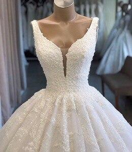 Image 5 - Nach Maß Ballkleid V ausschnitt Flauschigen Spitze Perlen Großen Zug Elegante Luxus Hochzeit Kleider Hochzeit Kleider Vestido De Noiva DA12