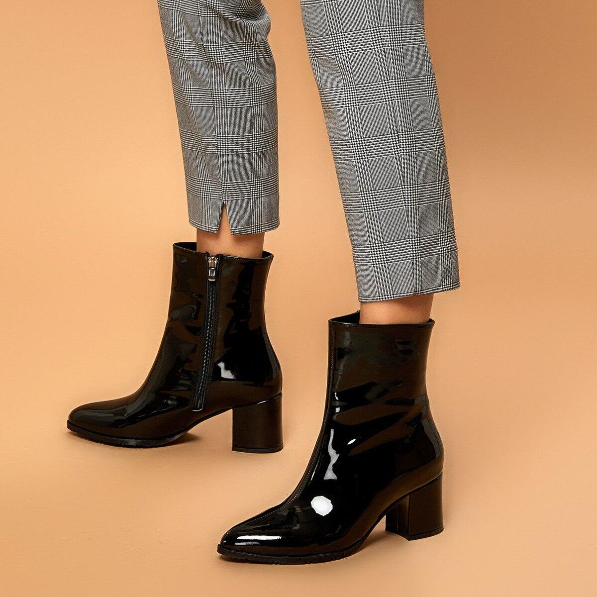 حذاء بوت نسائي أسود عالي الكعب من FLO موديل BUTIGO