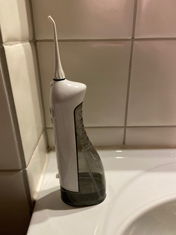 Jato de água Irrigador Oral elétrico para limpeza bucal Pro 100% Original photo review