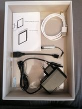 Conform to the description. Comes with the charger, a pen, 1 Cable, the protective cover,