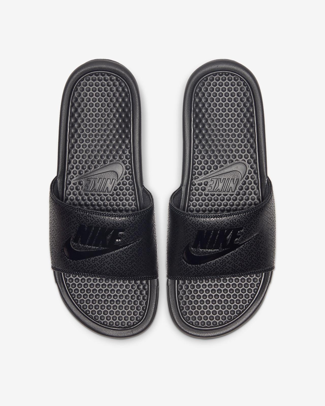 all black nike flip flops