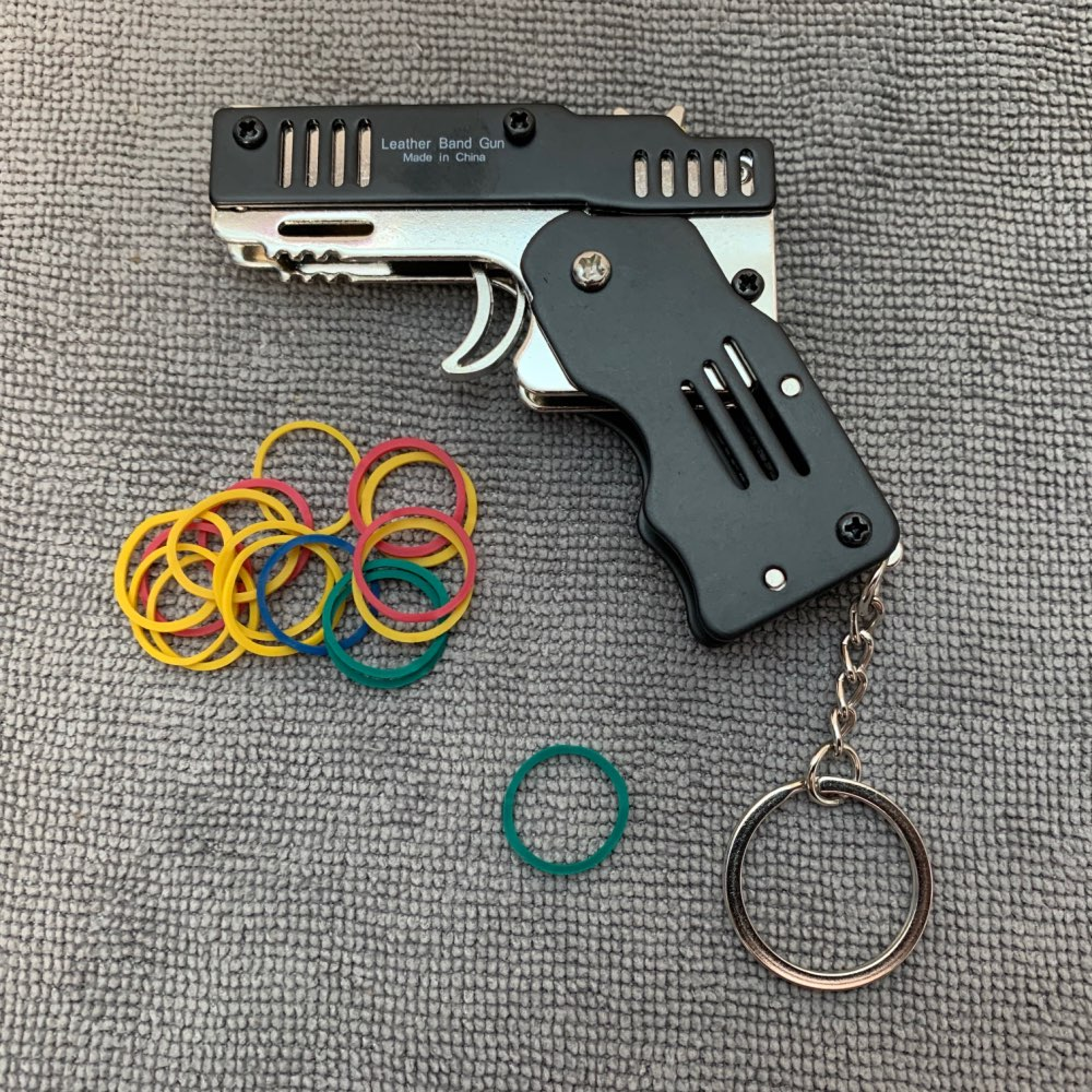 All Metal Mini Folding Rubber Band Toy Outdoor Military Sport Toy Keychain - vbersho photo review