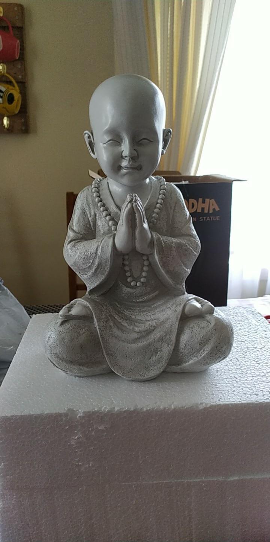 avis statue bouddha