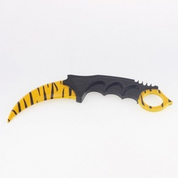 Kerambit made of wood tiger tooth