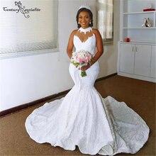 Белого цвета в африканском стиле свадебное платье с силуэтом
