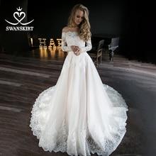 W stylu Vintage z długim rękawem suknia ślubna z aplikacjami Swanskirt iluzja koronki zroszony linii suknia ślubna księżniczka Vestido De Noiva HZ19