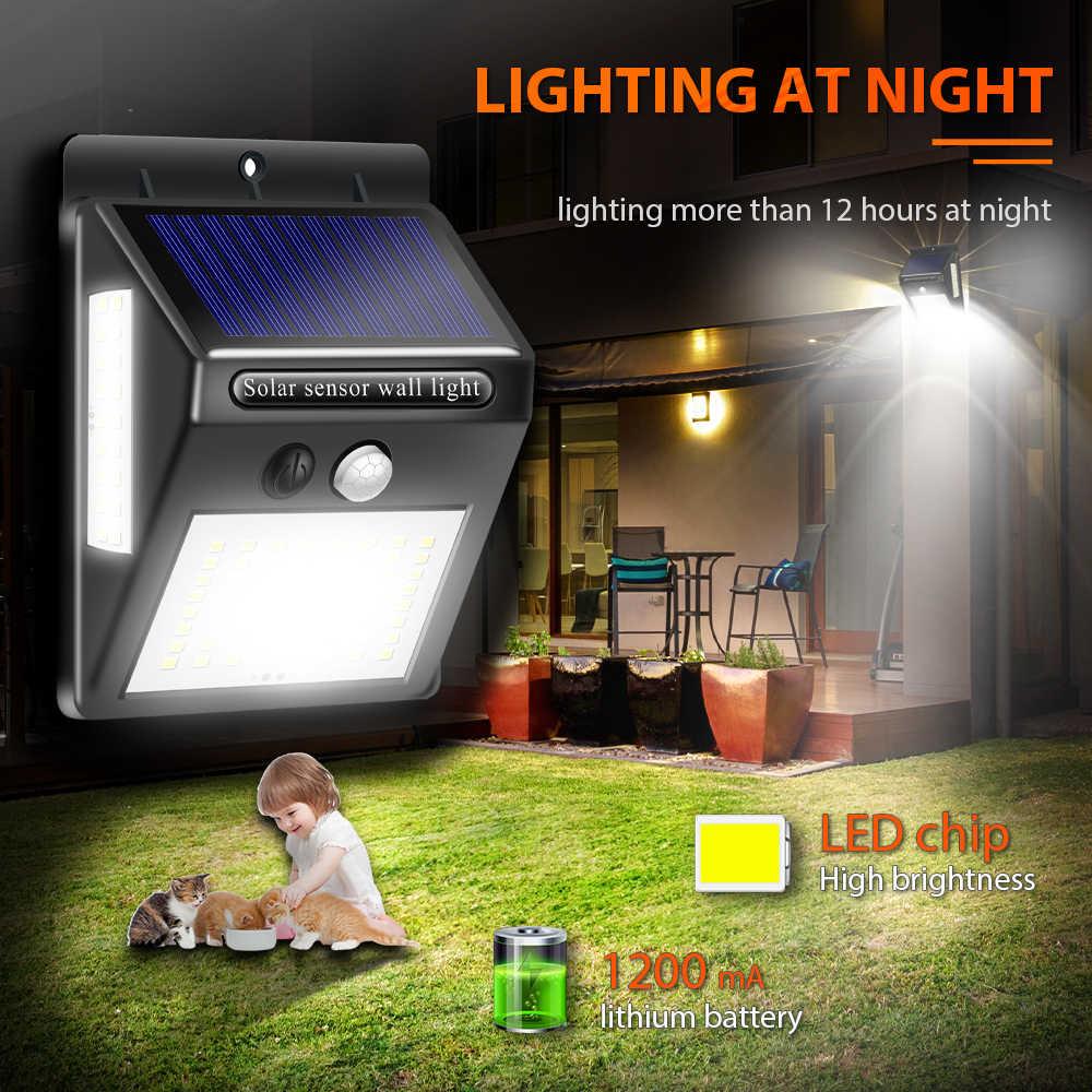 Inghoo 100LED luz solar impermeable lámpara solar con detección de movimiento al aire libre prisma jardín luces patio luces super brillo luz de pared