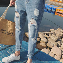 1484f6e8fb9 The Spring Trend 2019 Light Blue Small-footed Jeans Tide Men Hole Nine  Points Pants