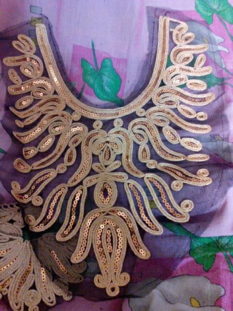 Вышивка хорошая. В золотом цвете. Покупала в первый раз себе:платье украсила. Все подумали,что новое купила. Кто любит этнический стиль,аксессуары, бижутерию -берите,не пожалеете!